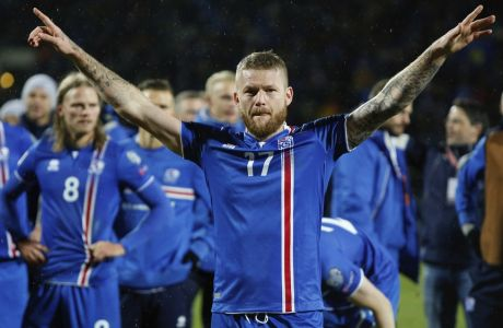 Iceland's captain Aron Gunnarsson celebrates at the end of the World Cup Group I qualifying soccer match between Iceland and Kosovo in Reykjavik, Iceland, Monday Oct. 9, 2017. (AP Photo/Brynjar Gunnarsson)