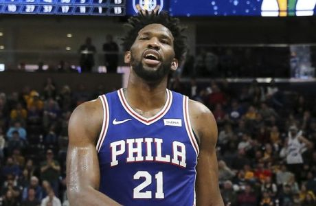 Philadelphia 76ers center Joel Embiid (21) walks off of the court after getting his sixth foul of the game against the Utah Jazz during the second half of an NBA basketball game, Thursday, Dec. 27, 2018, in Salt Lake City. The 76ers won 114-97. (AP Photo/Chris Nicoll)