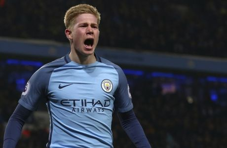 Manchester City's Kevin De Bruyne celebrates after scoring his sides 2nd goal of the game during the English Premier League soccer match between Manchester City and Tottenham Hotspur at the Etihad stadium in Manchester, England, Saturday, Jan., 21, 2017. (AP Photo/Dave Thompson)
