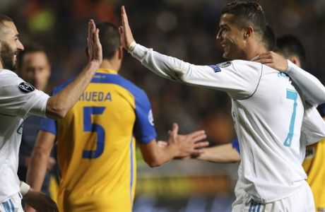 Real Madrid's Cristiano Ronaldo, right, celebrates after scoring the sixth goal of his team with Karim Benzema during the Champions League Group H soccer match between APOEL Nicosia and Real Madrid at GSP stadium, in Nicosia, on Tuesday, Nov. 21, 2017. (AP Photo/Petros Karadjias)