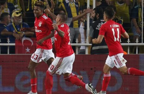 Benfica's Gedson Fernandes, left, celebrates after scoring the opening goal during the Champions League third qualifying round, second leg, soccer match between Fenerbahce and Benfica at the Sukru Saracoglu stadium in Istanbul, Tuesday, Aug. 14, 2018. (AP Photo/Lefteris Pitarakis)