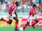 Ο Ρασίντ Γεκινί και ο Φαμπιάν Εστάι από το Ολυμπιακός-Απόλλων 3-1 στην πρεμιέρα του πρωταθλήματος της σεζόν 1994-95