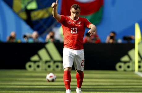 Switzerland's Xherdan Shaqiri gestures during the round of 16 match between Switzerland and Sweden at the 2018 soccer World Cup in the St. Petersburg Stadium, in St. Petersburg, Russia, Tuesday, July 3, 2018. (AP Photo/Darko Bandic)