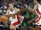 Boston Celtics' Kendrick Perkins (43) tries to keep the ball from Golden State Warriors' Stephen Curry (30) during the first half of an NBA basketball game Monday, Dec. 28, 2009, in Oakland, Calif. (AP Photo/Ben Margot)