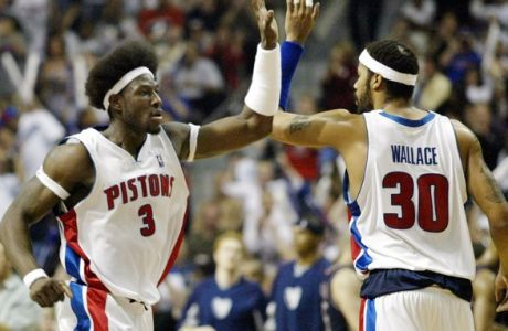 Detroit Pistons center Ben Wallace, (3), high-fives teammate Rasheed Wallace (30) in the second quarter of the game against the New Jersey Nets  of game 7 of their NBA Eastern Conference semi-finals at the Palace in Auburn Hills, Mich., Thursday, May 20, 2004. (AP Photo/Duane Burleson)