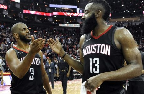 Houston Rockets guard Chris Paul (3) and James Harden celebrate the team's win over the Utah Jazz during Game 5 of an NBA basketball second-round playoff series, Tuesday, May 8, 2018, in Houston. (AP Photo/Eric Christian Smith)
