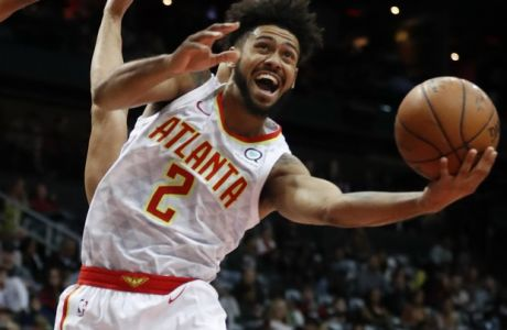 Atlanta Hawks guard Tyler Dorsey (2) goes up for as shot as San Antonio Spurs forward Kyle Anderson (1) defends in the second half of an NBA basketball game Monday, Jan. 15, 2018, in Atlanta. The Hawks won 102-99. (AP Photo/John Bazemore)
