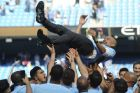 Manchester City players lift manager Josep Guardiola during celebrations for winning the English Premier League title after the soccer match between Manchester City and Huddersfield Town at Etihad stadium in Manchester, England, Sunday, May 6, 2018. (AP Photo/Rui Vieira)