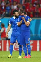 RECIFE, BRAZIL - JUNE 29:  Theofanis Gekas of Greece is consoled by Giorgos Tzavellas after being defeated in a penalty shootout during the 2014 FIFA World Cup Brazil Round of 16 match between Costa Rica and Greece at Arena Pernambuco on June 29, 2014 in Recife, Brazil.  (Photo by Quinn Rooney/Getty Images)