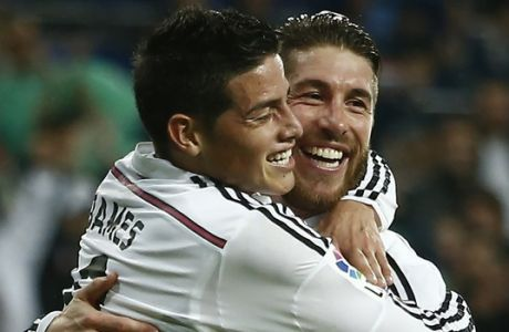 Real Madrid Sergio Ramos, right, celebrates his goal with teammate James Rodriguez, left, during a Spanish La Liga soccer match against Rayo Vallecano at the Santiago Bernabeu stadium in Madrid, Spain, Saturday, Nov. 8, 2014. (AP Photo/Andres Kudacki)