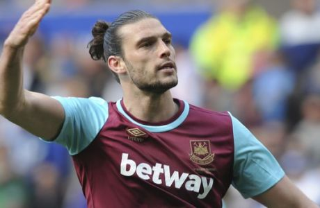 FILE - This is a Sunday, April 17, 2016  file photo of  West Ham United's Andy Carroll as he celebrates after scoring his sides first goal from the penalty spot during the English Premier League soccer match between Leicester City and West Ham United at the King Power Stadium in Leicester. West Ham manager Slaven Bilic said Thursday Nov. 3, 2016,  Andy Carroll was targeted by armed motorcyclists as the striker left the Premier League club's training ground. Carroll told West Ham he was confronted at a junction on Wednesday. (AP Photo/Rui Vieira, File)