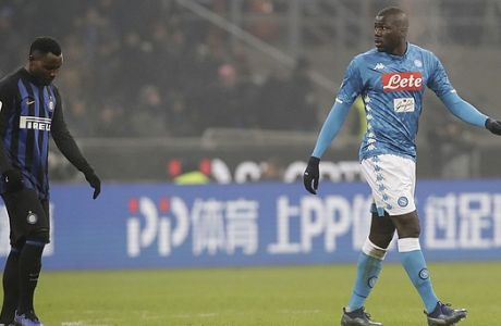 "In this image taken on Wednesday, Dec.26, Napoli's Kalidou Koulibaly, right, leaves the pitch after receiving a red card from the referee during a Serie A soccer match between Inter Milan and Napoli, at the San Siro stadium in Milan, Italy. At left is Inter Milan's Kwadwo Asamoah. Cristiano Ronaldo has come to the defense of Kalidou Koulibaly after the Napoli defender was the target of racist chants during a match at Inter Milan. Next to a photo of him being marked by Koulibaly during a match earlier this season, Ronaldo writes on Instagram, ""In the world and in football there always needs to be education and respect. No to racism and to any sort of insult and discrimination!!!"". (AP Photo/Luca Bruno, File)"