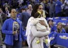 Ayesha Curry, right, wife of Golden State Warriors' Stephen Curry, holds daughter Ryan as they arrive at the NBA basketball game against the New Orleans Pelicans Tuesday, Oct. 27, 2015, in Oakland, Calif. (AP Photo/Ben Margot)