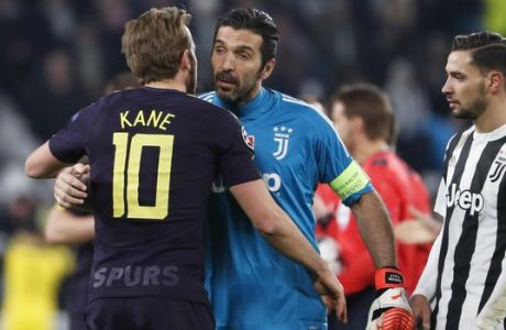 Juventus goalkeeper Gianluigi Buffon greets Tottenham's Harry Kane, left, as Juventus' Mattia de Sciglio looks at them, at the end of the Champions League, round of 16, first-leg soccer match between Juventus and Tottenham Hotspurs, at the Allianz Stadium in Turin, Italy, Tuesday, Feb. 13, 2018. The match need in a 2-2 draw. (AP Photo/Antonio Calanni)