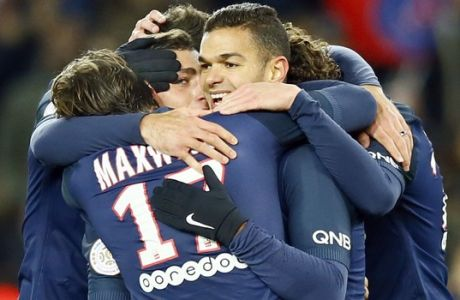 PSG's Hatem Ben Arfa, center, reacts with teammates after scoring the fourth goal during their French League One soccer match between PSG and Marseille at the Parc des Princes stadium in Paris, France, Sunday, Nov. 6, 2016. (AP Photo/Francois Mori)