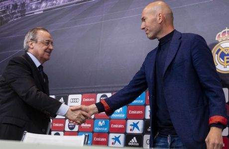 Zinedine Zidane shakes hands with President of Real Madrid, Florentino Perez, during a press conference in Madrid, Spain, Thursday, May 31, 2018. Zinedine Zidane quit as Real Madrid coach on Thursday, less than a week after leading the team to its third straight Champions League title, saying the club needed a change in command. (AP Photo/Borja B. Hojas)