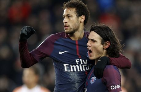 PSG's Edinson Cavani, right, and PSG's Neymar celebrates his goal during their French League One soccer match between Paris Saint Germain and Montpellier at the Parc des Princes stadium in Paris, Saturday, Jan. 27, 2018. (AP Photo/Christophe Ena)