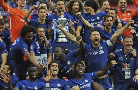 Chelsea players celebrate with the trophy after winning the English FA Cup final soccer match between Chelsea v Manchester United at Wembley stadium in London, England, Saturday, May 19, 2018. (AP Photo/Rui Vieira)
