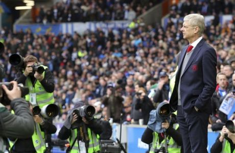 Arsenal manager Arsene Wenger follows the game, during the English Premier League soccer match between Brighton and Arsenal at the AMEX Stadium, in Brighton, England, Sunday March 4, 2018. (Gareth Fuller/PA via AP)