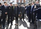 Britain's Prime Minister Theresa May, centre, is briefed by members of the police as she views the area where former Russian double agent Sergei Skripal and his daughter were found critically ill, in Salisbury, England, Thursday, March 15, 2018.  May on Wednesday expelled 23 Russian diplomats, severed high-level contacts and vowed both open and covert action following the incident. (Toby Melville/PA via AP)