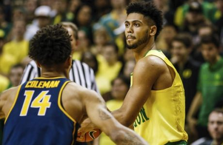 Oregon Ducks guard Tyler Dorsey (5) looks for a pass against California defenders in an NCAA college basketball game Thursday, Jan. 19, 2016, in Eugene, Ore. (AP Photo/Thomas Boyd)