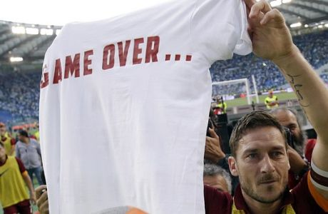 Roma's Francesco Totti, center, shows a jersey reading ' Game Over ' to photographers as he celebrates at the end of a Serie A soccer match between Lazio and Roma, at Rome's Olympic Stadium, Monday, May 25, 2015. Roma won 2-1. (AP Photo/Gregorio Borgia)