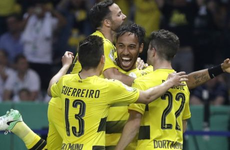 Dortmund's scorer Pierre-Emerick Aubameyang, center, and his teammates celebrate their side's 2nd goal during the German soccer cup final match between Borussia Dortmund and Eintracht Frankfurt in Berlin, Germany, Saturday, May 27, 2017. (AP Photo/Michael Sohn)