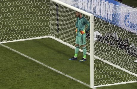 Spain goalkeeper David De Gea reacts after Portugal's Cristiano Ronaldo scored his side's 3rd goal during the group B match between Portugal and Spain at the 2018 soccer World Cup in the Fisht Stadium in Sochi, Russia, Friday, June 15, 2018. (AP Photo/Thanassis Stavrakis)