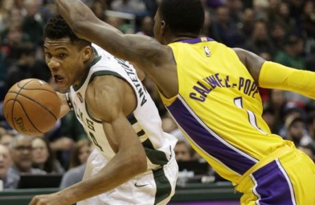 Milwaukee Bucks forward Giannis Antetokounmpo, left, drives to the basket against Los Angeles Lakers guard Kentavious Caldwell-Pope, right, during the second half of an NBA basketball game Saturday, Nov. 11, 2017, in Milwaukee. Bucks defeated the Lakers 98-90. (AP Photo/Darren Hauck)
