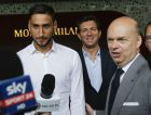 AC Milan goalie Gianluigi Donnarumma, left, is flanked by team CEO Marco Fassone at the 'Casa Milan', AC Milan team headquarters, in Milan Italy, Wednesday, July 12, 2017. AC Milan's teenage goalkeeper Gianluigi Donnarumma has agreed to extend his contract with the Serie A club until 2021. The talented 18-year-old turned down a new deal last month and would have been a free agent at the end of next season. On Tuesday, Milan announced it had reached an agreement with Donnarumma, saying he would sign a new four-year contract the following morning. (AP Photo/Luca Bruno)