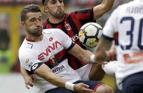 AC Milan's Ricardo Rodriguez, right, challenges for the ball with Cagliari's Andrey Galabinov during a Serie A soccer match between AC Milan and Genoa, at the San Siro stadium in Milan, Italy, Sunday, Oct. 22, 2017. (AP Photo/Luca Bruno)