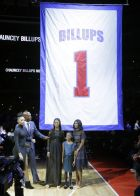 Chauncey Billups stands with his daughters Ciara, left, Cydney and Cenaiya and his wife, Piper, right, during a halftime ceremony during an NBA basketball game where his jersey was retired, Wednesday, Feb. 10, 2016 in Auburn Hills, Mich. (AP Photo/Carlos Osorio)