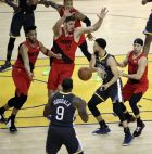 Golden State Warriors' Stephen Curry passes to Andre Iguodala (9) as Portland Trail Blazers' Seth Curry, right, and Meyers Leonard (11) defend during the second half of Game 2 of the NBA basketball playoffs Western Conference finals Thursday, May 16, 2019, in Oakland, Calif. (AP Photo/Ben Margot)