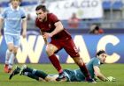 Roma's Kevin Strootman celebrates past Lazio goalkeeper Federico Marchetti after scoring during a Serie A soccer match between Lazio and Roma, at the Rome Olympic stadium Sunday, Dec. 4, 2016. (AP Photo/Gregorio Borgia)