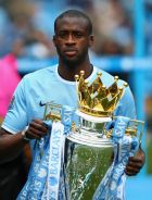 MANCHESTER, ENGLAND - MAY 11:   Yaya Toure of Manchester City poses with the trophy at the end of the Barclays Premier League match between Manchester City and West Ham United at the Etihad Stadium on May 11, 2014 in Manchester, England.  (Photo by Alex Livesey/Getty Images)