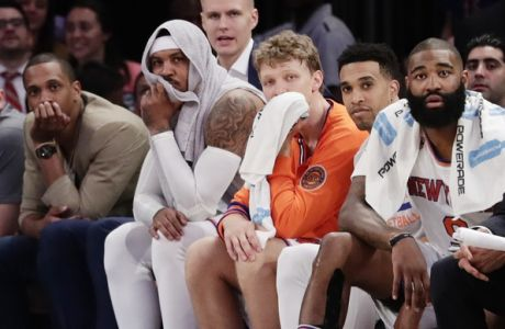 New York Knicks' Carmelo Anthony, center, and Kristaps Porzingis, above, watch during the second half of an NBA basketball game against the Philadelphia 76ers Wednesday, April 12, 2017, in New York. The Knicks won 114-113. (AP Photo/Frank Franklin II)