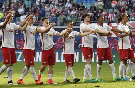 Leipzig players celebrate after the German first division Bundesliga soccer match between RB Leipzig and SV Darmstadt 98 in Leipzig, Germany, Saturday, April 1, 2017.  (AP Photo/Jens Meyer)