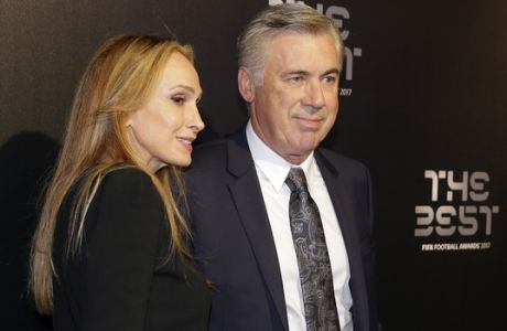 Soccer coach Carlo Ancelotti and his wife Barrena McClay arrive to attend the The Best FIFA 2017 Awards at the Palladium Theatre in London, Monday, Oct. 23, 2017. (AP Photo/Alastair Grant)