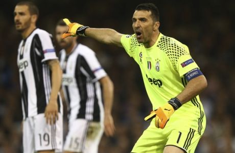 Juventus goalkeeper Gianluigi Buffon organizes his defense during the Champions League final soccer match between Juventus and Real Madrid at the Millennium stadium in Cardiff, Wales Saturday June 3, 2017. (AP Photo/Dave Thompson)