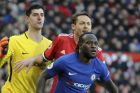Chelsea's Thibaut Courtois, left, Manchester United's Nemanja Matic, centre, and Chelsea's Victor Moses during the English Premier League soccer match between Manchester United and Chelsea at the Old Trafford stadium in Manchester, England, Sunday, Feb. 25, 2018. (AP Photo/Rui Vieira)