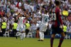 Real Madrid's Lucas Vazquez, left, celebrates with teammate Sergio Ramos after scoring their side's first goal against Levante during the Spanish La Liga soccer match between Real Madrid and Levante at the Santiago Bernabeu stadium in Madrid, Saturday, Sept. 9, 2017. (AP Photo/Francisco Seco)