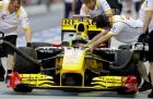 Renault Formula One driver Robert Kubica of Poland has his car pushed along pit lane by his pit crew during the first practice session for the Singapore Grand Prix on the Marina Bay City Circuit in Singapore, Friday, Sept. 24, 2010. (AP Photo/Ng Han Guan)