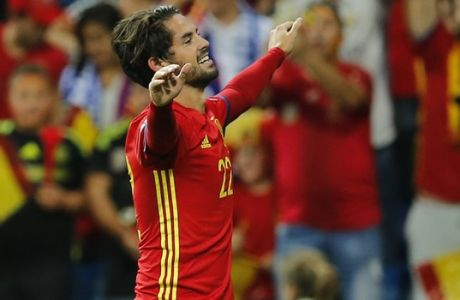 Spain's Isco celebrates after scoring the opening goal during the World Cup Group G qualifying soccer match between Spain and Italy at the Santiago Bernabeu Stadium in Madrid, Saturday Sept. 2, 2017. (AP Photo/Paul White)