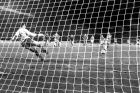 Michel Platini from the Juventus Turin soccer team scores the 1-0 for his team Wednesday evening, May 29, 1985 in the Brussels Heysel stadium as FC Liverpool goalkeeper Bruce Grobbelaar jumps into the wrong corner at this penalty shot of the European Champion's Cup Final. (AP-PHOTO)
