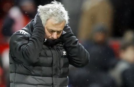 Manchester United head coach Jose Mourinho reacts during the English FA Cup quarterfinal soccer match between Manchester United and Brighton, at the Old Trafford stadium in Manchester, England, Saturday, March 17, 2018. (AP Photo/Frank Augstein)