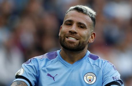 Manchester City's Nicolas Otamendi reacts during the English Premier League soccer match between Manchester City and Tottenham Hotspur at Etihad stadium in Manchester, England, Saturday, Aug. 17, 2019. (AP Photo/Rui Vieira)