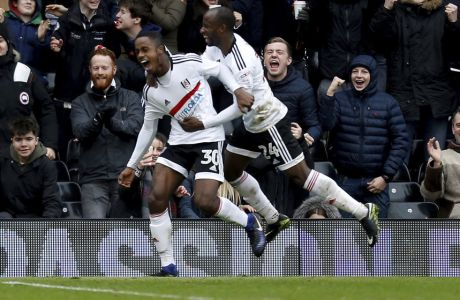 Fulham's Ryan Sessegnon celebrates scoring his side's third goal of the game with Sone Aluko, right, during the English FA Cup, Fourth Round match, Fulham vs Hull City at Craven Cottage, London, Sunday Jan. 29, 2017. (Paul Harding/PA via AP)