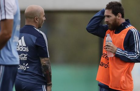 Argentina's Lionel Messi, right, talks to soccer coach Jorge Sampaoli during a training session in preparation for an upcoming 2018 Russia World Cup qualifying soccer match against Uruguay, in Buenos Aires, Argentina, Monday, Aug. 28, 2017. (AP Photo/Natacha Pisarenko)