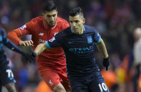 Liverpool's Emre Can, centre, fights for the ball against Manchester City's Sergio Aguero during the English Premier League soccer match between Liverpool and Manchester City at Anfield Stadium, Liverpool, England, Wednesday, March 2, 2016. (AP Photo/Jon Super)