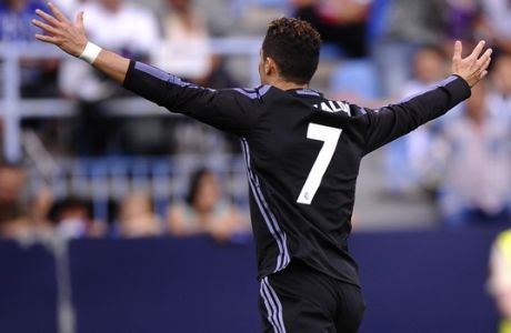 Real Madrid's Cristiano Ronaldo celebrates scoring the opening goal during a Spanish La Liga soccer match between Malaga and Real Madrid in Malaga, Spain, Sunday, May 21, 2017. (AP Photo/Daniel Tejedor)